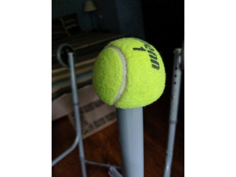 Tennis ball on walker leg