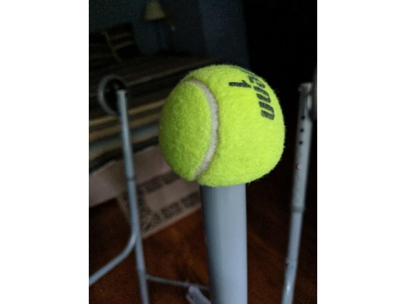 Tennis ball on walker leg